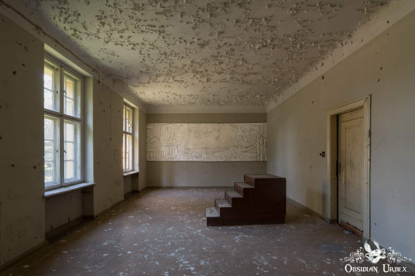 Haus der Offiziere Germany abandoned Nazi Soviet millitary base and town peeling paint and communist mural carving