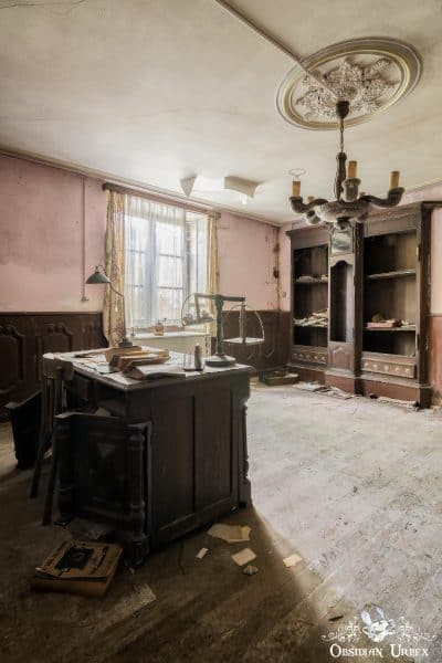 Maison Kirsch Luxembourg abandoned house office desk with chandelier