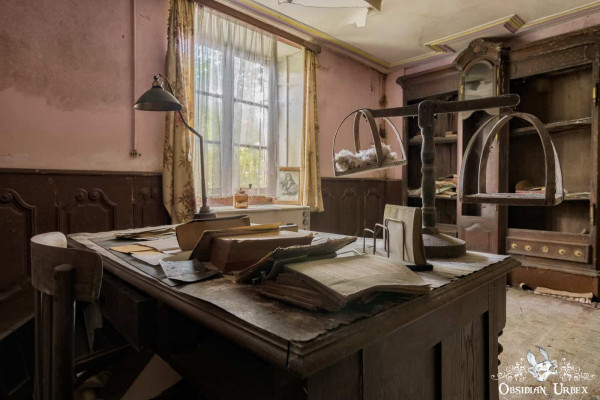 Maison Kirsch Luxembourg abandoned house office desk with scales lamp and books