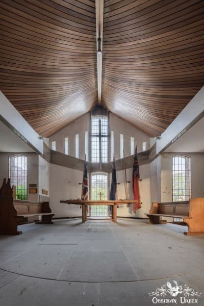 School of Malady England abandoned school chapel with pews and ceiling