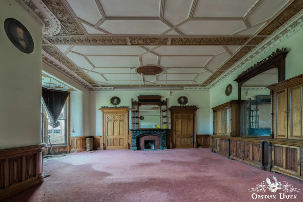 School of Malady England abandoned school office with wood doors and portraits
