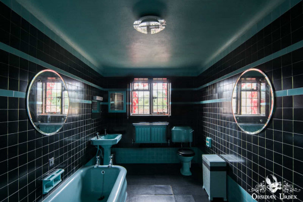 Rockstar Mansion England abandoned manor house black and turqouise bathroom