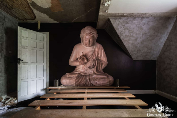 Rockstar Mansion England abandoned manor house painting of Buddha in Lotus Position