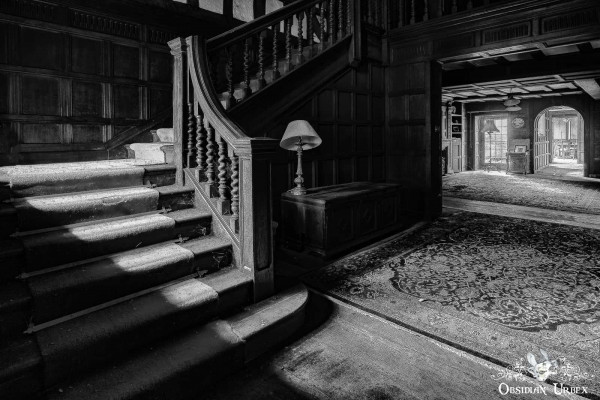 Rockstar Mansion England abandoned manor house stairs in black and white